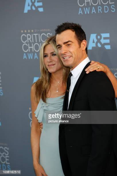 Actress Jennifer Aniston and Justin Theroux arrive at the 21st Annual CriticsÕ Choice Awards at Barker Hangar at Santa Monica Airport in Los Angeles...