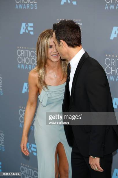 Actress Jennifer Aniston and Justin Theroux arrive at the 21st Annual Critics' Choice Awards at Barker Hangar at Santa Monica Airport in Los Angeles...
