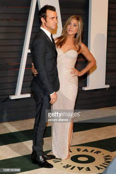 Actress Jennifer Aniston and Justin Theroux attend the Vanity Fair Oscar Party at Wallis Annenberg Center for the Performing Arts in Beverly Hills...