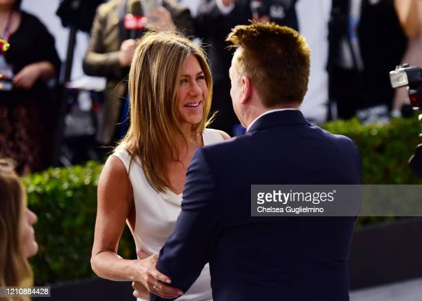Actress Jennifer Aniston and Kevin Huvane attend the 26th annual Screen ActorsGuild Awards at The Shrine Auditorium on January 19 2020 in Los...
