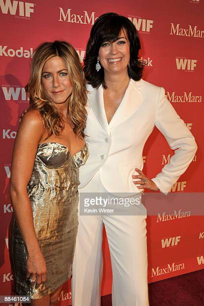 Actress Jennifer Aniston and President of Women in Film Jane Fleming arrivee at the Women In Film 2009 Crystal And Lucy Awards at the Hyatt Regency...