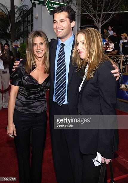 Actress Jennifer Aniston and production presidents Scott Stuber and Mary Parent attend the premiere of Bruce Almighty at Universal Studios May 14...