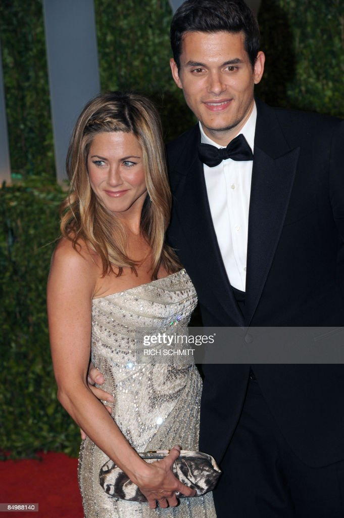 Actress Jennifer Aniston and singer John : News Photo