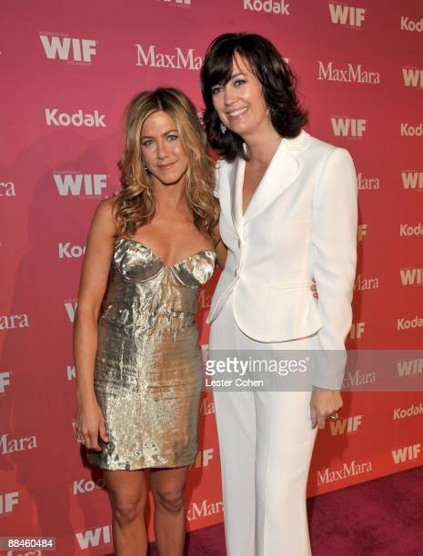 Actress Jennifer Aniston and Women In Film president Jane Fleming arrive at the Women In Film 2009 Crystal Lucy Awards at the Hyatt Regency Century...