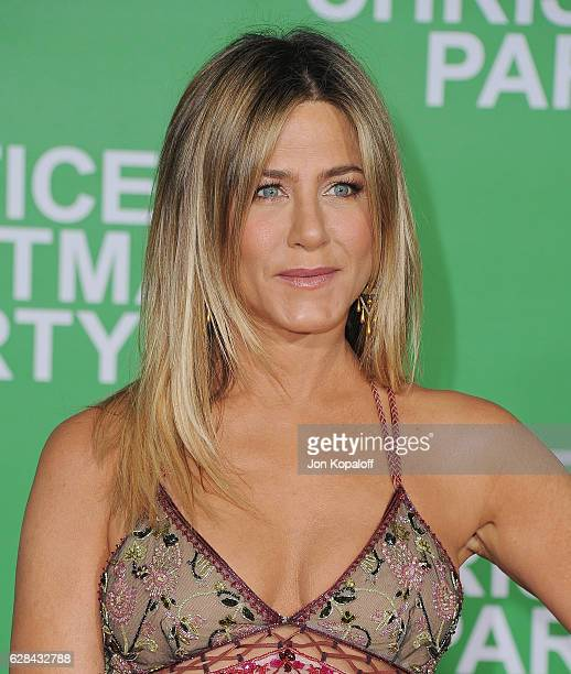 "Actress Jennifer Aniston arrives at the Los Angeles Premiere ""Office Christmas Party"" at Regency Village Theatre on December 7, 2016 in Westwood,..."