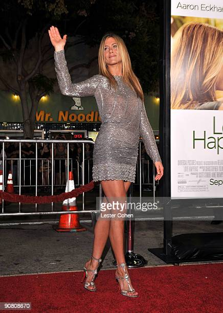 Actress Jennifer Aniston arrives on the red carpet at the Los Angeles premiere of 'Love Happens' at the Mann's Village Theatre on September 15 2009...