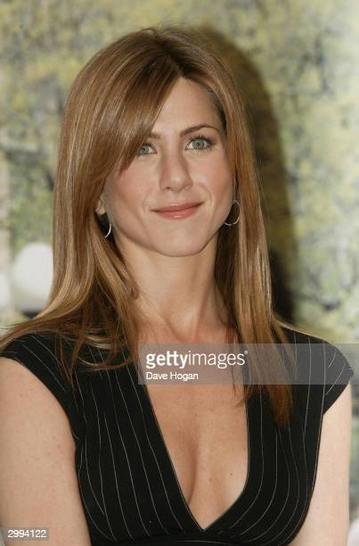Actress Jennifer Aniston attends a photocall to promote the romantic comedy 'Along Came Polly' at the Mandarin Oriental Hotel on February 18 2004 in...