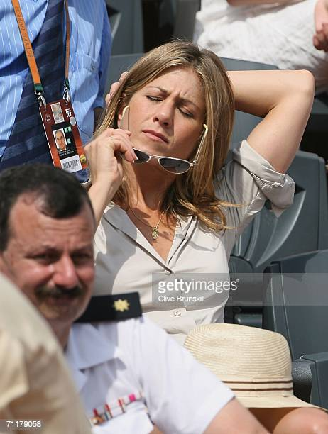 Actress Jennifer Aniston attends the men's singles final between Roger Federer of Switzerland and Rafael Nadal of Spain during the French Open at...