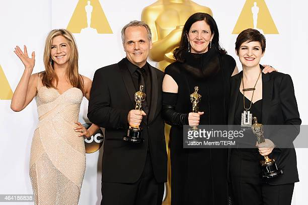 Actress Jennifer Aniston Dirk Wilutzky director Laura Poitras and Mathilde Bonnefoy winners of est Documentary Feature Award for 'Citizenfour' pose...