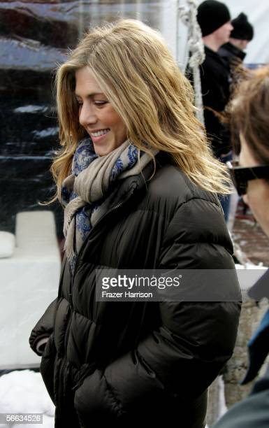 Actress Jennifer Aniston exits a press conference during the 2006 Sundance Film Festival on Main Street January 20 2006 in Park City Utah