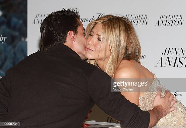 Actress Jennifer Aniston kisses a fan while she signs copies of her new perfume 'Jennifer Aniston' at Palacio De Hierro Polanco on March 10 2011 in...