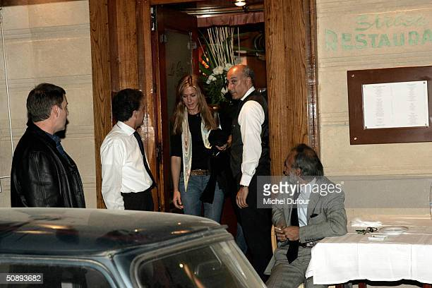 Actress Jennifer Aniston leave the restaurant Le Stresa with actor Brad Pitt after arriving May 24 2004 in Paris France Pitt arrived in Paris to film...