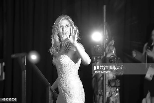Actress Jennifer Aniston leaves the press photo room at the 87th Annual Academy Awards at Dolby Theatre February 22 2015 in Hollywood California