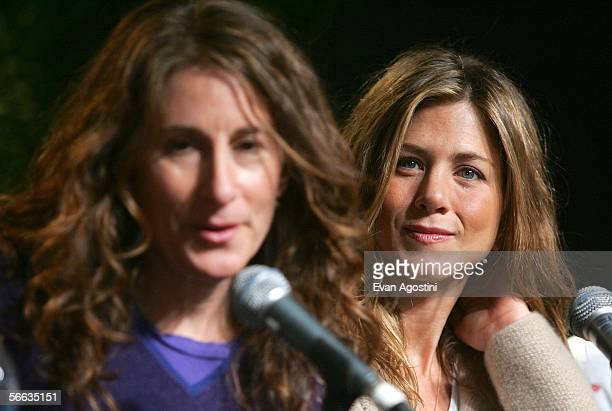 Actress Jennifer Aniston listens as director Nicole Holofcener speaks at the Friends with Money Press Conference at the Kimball Art Center during the...