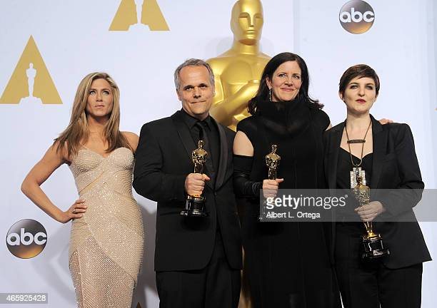 Actress Jennifer Aniston, Mathilde Bonnefoy, director Laura Poitras, and Dirk Wilutzky, winners of Best Documentary Feature Award for 'Citizenfour'...