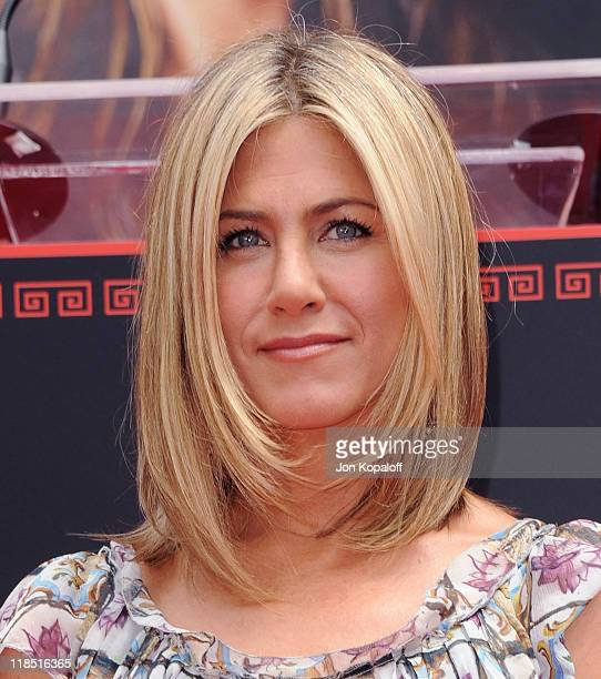 Actress Jennifer Aniston poses at the Jennifer Aniston Hand Footprint Ceremony At Grauman's Chinese Theatre at Grauman's Chinese Theatre on July 7...