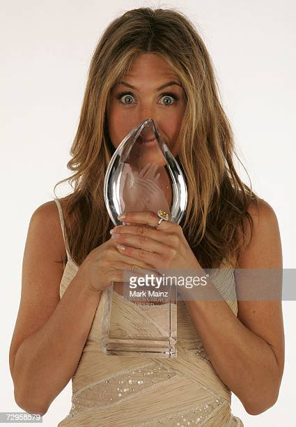 Actress Jennifer Aniston poses in the portrait studio with her Favorite Female Movie Star Award during the 33rd Annual People's Choice Awards held at...