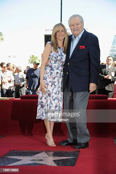 Actress Jennifer Aniston poses who was honored with a star the the Hollywood Walk Of Fame poses with her father John Aniston on February 22 2012 in...