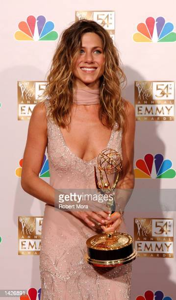 Actress Jennifer Aniston poses with her Outstanding Lead Actress in a Comedy Series award for Friends backstage during the 54th Annual Primetime Emmy...