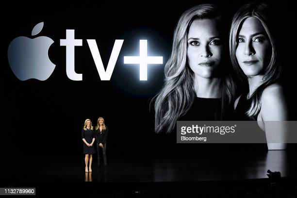 Actress Jennifer Aniston right speaks as actress Reese Witherspoon listens during an Apple Inc event at the Steve Jobs Theater in Cupertino...