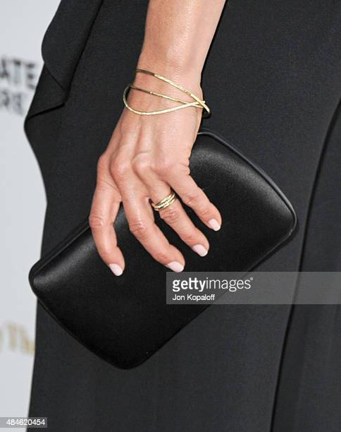 Actress Jennifer Aniston ring detail arrives at the Los Angeles Premiere She's Funny That Way at Harmony Gold on August 19 2015 in Los Angeles...
