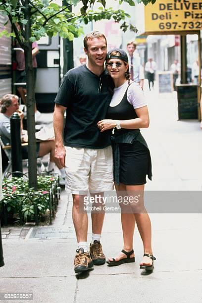 Actress Jennifer Aniston stands with her boyfriend actor Tate Donovan during the filming of her motion picture Picture Perfect