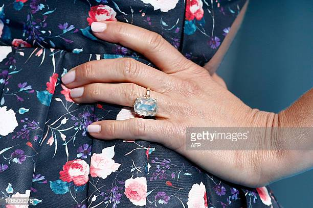US actress Jennifer Aniston wears her diamond engagement ring as she poses upon arrival to attend the European premiere of the film 'We're The...