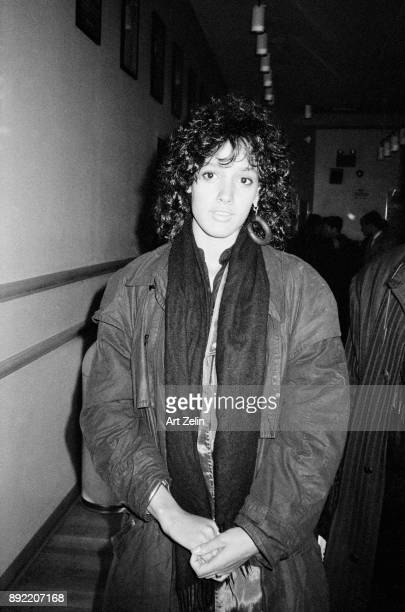 Actress Jennifer Beals poses for a quick snapshot in a coat and scarf New York City 1980