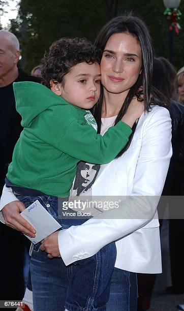 Actress Jennifer Connelly and son Kai attend the premiere of the animated film 'Jimmy Neutron Boy Genius' December 9 2001 at Paramount Studios in...