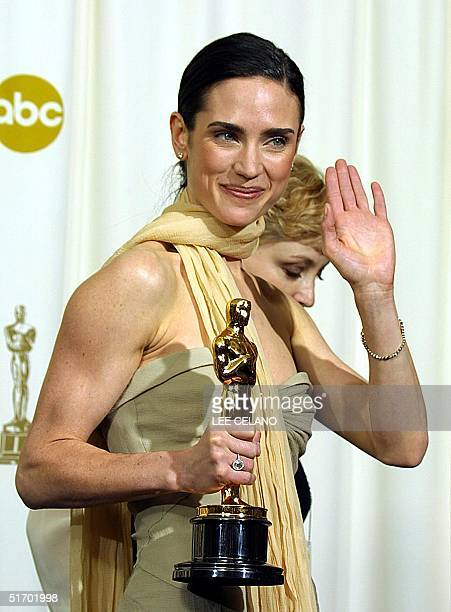 US actress Jennifer Connelly holds her Oscar for best actress in a supporting role for her portrayal of Alicia Nash the wife of mathematician John...