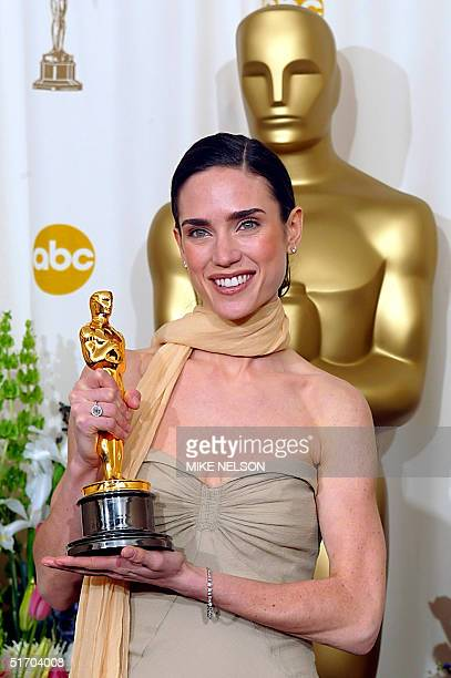 US actress Jennifer Connelly holds the Oscar after winning the award for best actress in a supporting role for her portrayal of Alicia Nash the wife...