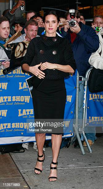 Actress Jennifer Connelly poses for photographers outside the Ed Sullivan theater after appearing on the 'Late Show with David Letterman' October 30...