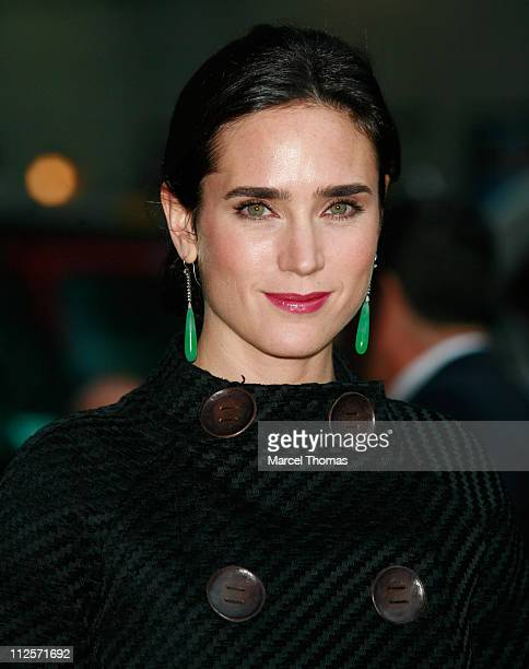 Actress Jennifer Connelly poses for photographers outside the Ed Sullivan theater after appearing on the Late Show with David Letterman October 30...