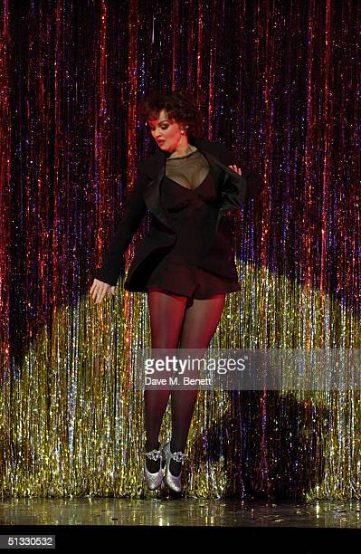 Actress Jennifer Ellison performs on stage in her new role as Roxie Hart in the West End musical Chicago at the Adelphi Theatre on September 20 2004...