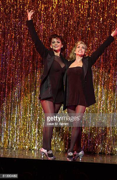 Actress Jennifer Ellison performs on stage with Anita Louise Combe in her new role as Roxie Hart in the West End musical Chicago at the Adelphi...