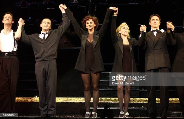 "Actress Jennifer Ellison performs on stage with Anita Louise Combe and John Barrowman in her new role as Roxie Hart in the West End musical ""Chicago""..."