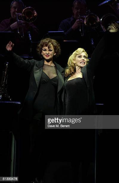 Actress Jennifer Ellison poses with Anita Louise Combe in her new role as Roxie Hart in the West End musical Chicago at the Adelphi Theatre on...