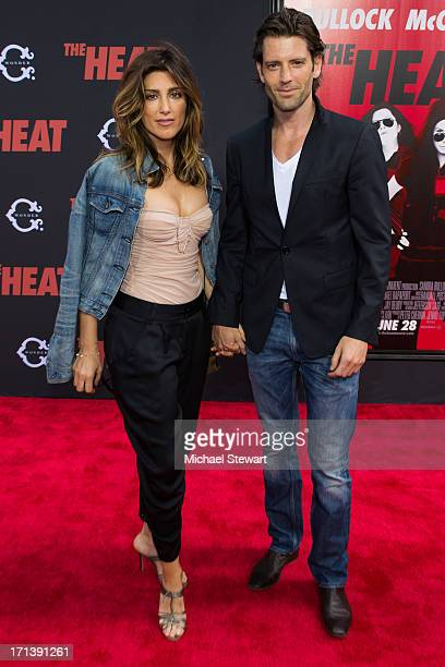 Actress Jennifer Esposito and model Louis Dowler attend The Heat New York Premiere at Ziegfeld Theatre on June 23 2013 in New York City