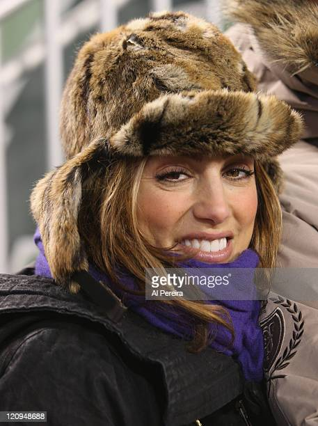 Actress Jennifer Esposito checks out the action on the sidelines when she attends the Cincinnati Bengals vs. New York Jets game at Giants Stadium on...