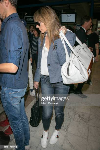 Actress Jennifer Flavin arrives ahead the 72nd annual Cannes Film Festival at Nice Airport on May 23 2019 in Nice France