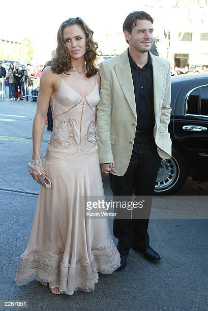 Actress Jennifer Garner and husband Scott Foley arrive at the premiere of 'Daredevil' at the Village Theatre on February 9 2003 in Los Angeles...