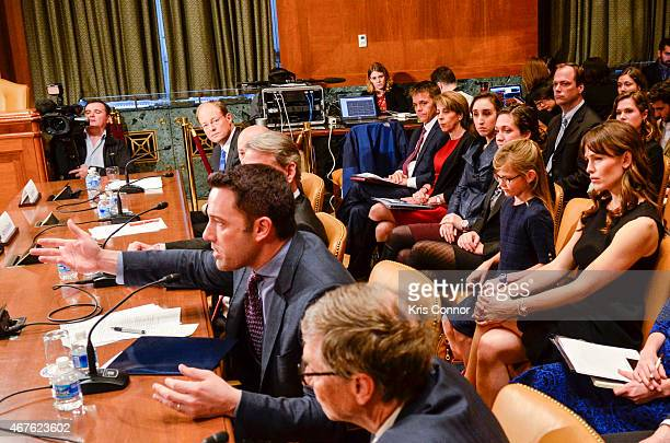 Actress Jennifer Garner listens as her husband actor Ben Affleck speak during a Senate Appropriations' subcommittee on State Foreign Operations and...