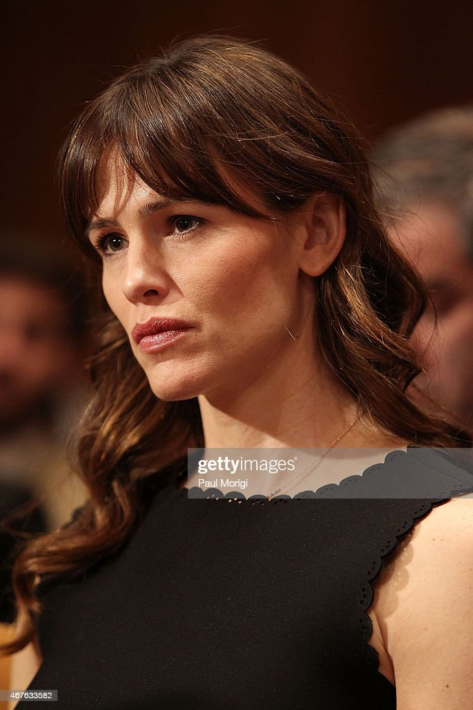 Actress Jennifer Garner listens as her husband, actor Ben Affleck, testifies before a Senate Appropriations State, Foreign Operations, and Related Programs Subcommittee hearing on 'Diplomacy, Development, and National Security' on Capitol Hill in Washington March 26, 2015.