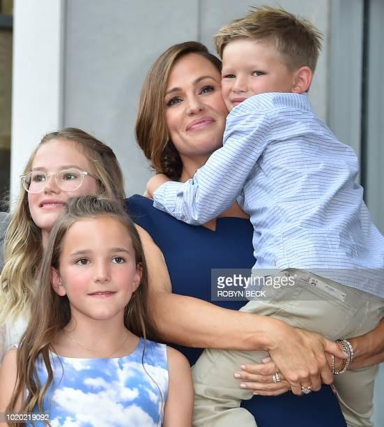 Actress Jennifer Garner poses with her children Violet Affleck Seraphina Rose Elizabeth Affleck and Samuel Garner Affleck at her star on the...