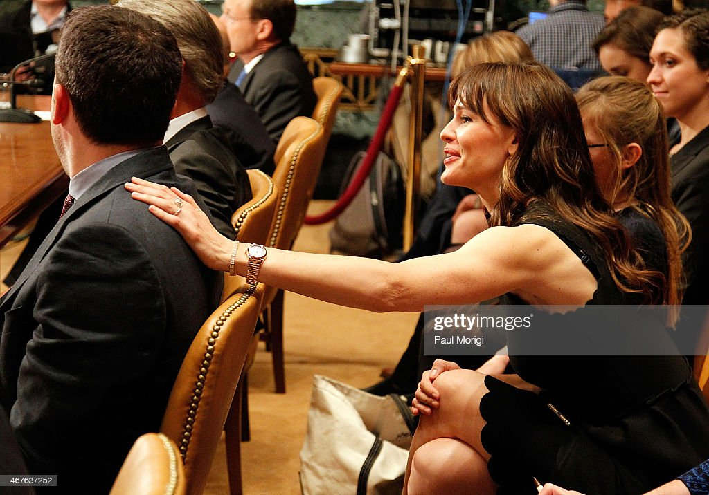Actress Jennifer Garner (R) shows support for her husband, Ben Affleck, as he testifies before a Senate Appropriations State, Foreign Operations, and Related Programs Subcommittee hearing on 'Diplomacy, Development, and National Security' on Capitol Hill in Washington March 26, 2015.