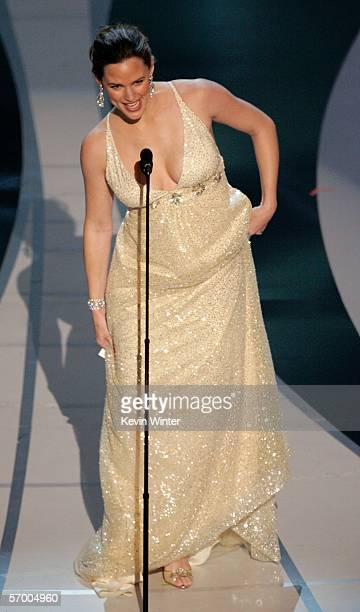 BROADCAST*** Actress Jennifer Garner stumbles as she presents the Achievement in Sound Editing award on stage during the 78th Annual Academy Awards...