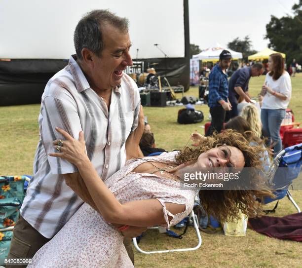 Actress Jennifer Grey and choreographer Kenny Ortega dance at the special screening of 'Dirty Dancing' at Will Rogers State Historic Park on...