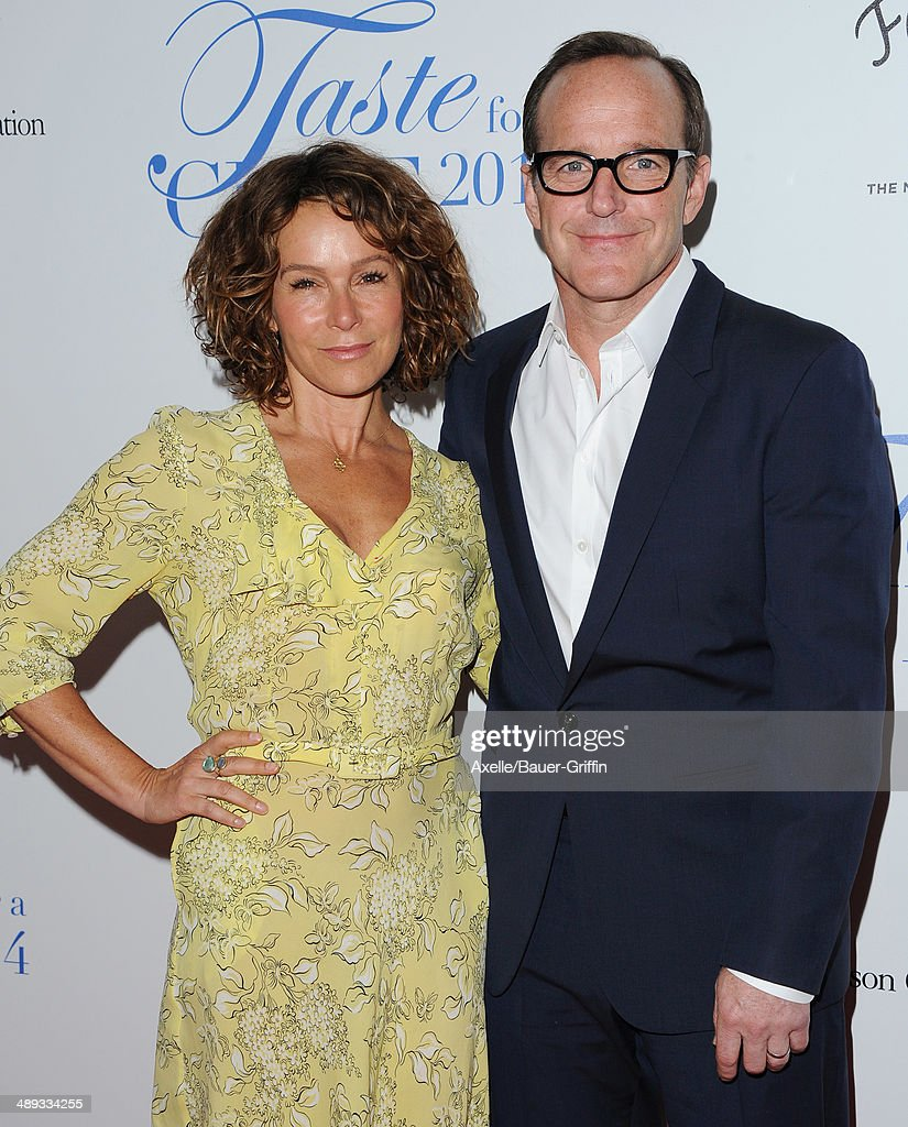 Actress Jennifer Grey and husband actor Clark Gregg arrive at the Jonsson Cancer Center Foundation's 19th Annual 'Taste For A Cure' at Regent Beverly Wilshire Hotel on April 25, 2014 in Beverly Hills, California.