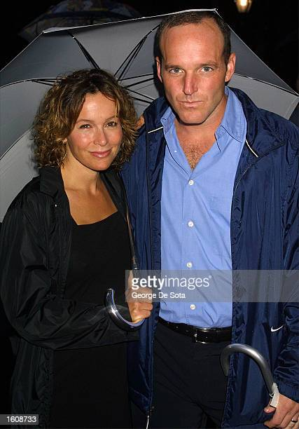 """Actress Jennifer Grey and husband attends a rainy openning night of """"The Seagull"""" August 12, 2001 at the Delacorte Theatre in New York City''s..."""