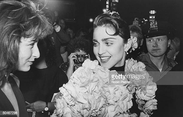 Actress Jennifer Grey chatting w singer Madonna at Tony Awards party at Sardi's restaurant